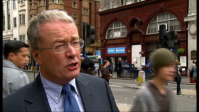 london oxford street ext reporter to camera colin barrow interview sot pedestrians along outside oxford circus station - oxford circus stock videos and b-roll footage