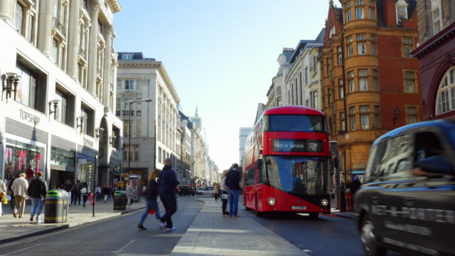 london oxford street to the east (4k/uhd) - double decker bus stock videos & royalty-free footage