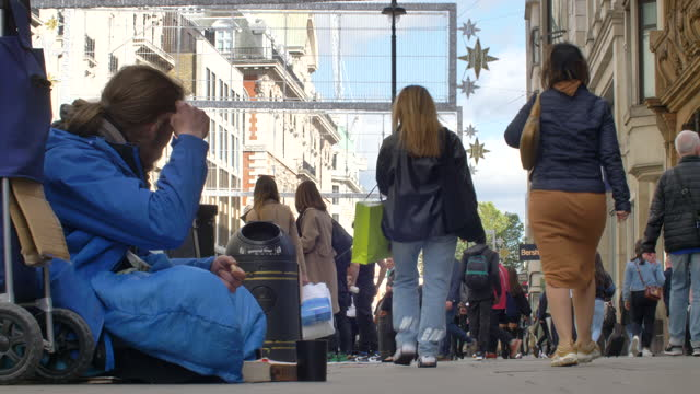 london oxford street west end shoppers crowd 50% masked 2021 sunny day homeless man begging - housing difficulties stock videos & royalty-free footage
