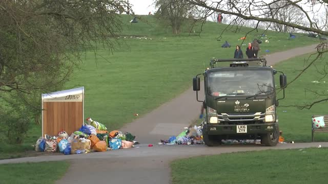 london parks littered with rubbish after sunny day; england: london: primrose hill: ext / dawn wide shot of park covered in litter, london skyline in... - weather stock videos & royalty-free footage