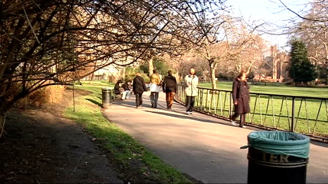 london parks to get 'makeovers' england london ext people along through unidentified london park people seated on bench in park eating sandwiches - sandwich stock videos & royalty-free footage