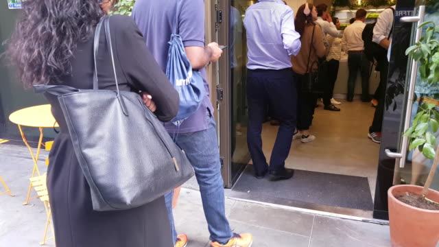 london people waiting in line at lunch restaurant - employee stock videos & royalty-free footage