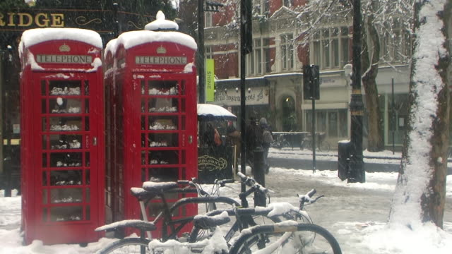 MS London phone boxes covered in snow, London, United Kingdom