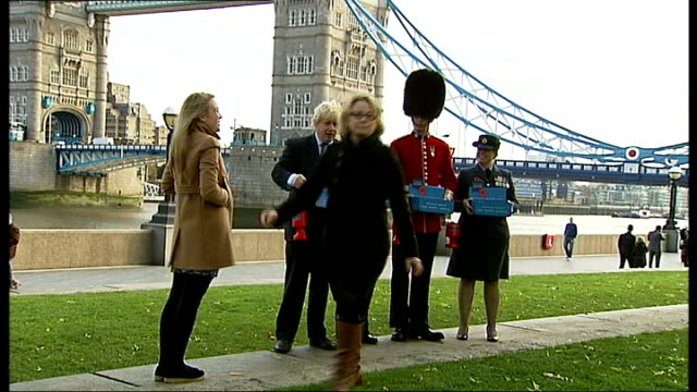 london poppy day launch and photocall england london ext boris johnson arriving and posing with service men and woman at launch of london poppy day... - mayor stock videos & royalty-free footage