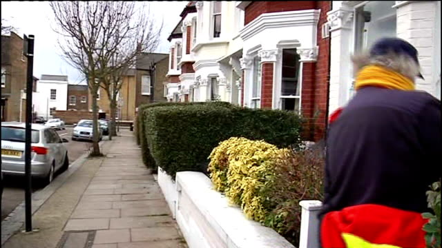 postal worker towards then delivering letters thru front door letterboxes - mail stock videos & royalty-free footage