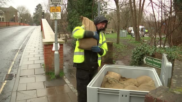 london prepares for storm dennis england surrey leatherhead ext various of environment agency workers erecting temporary flood barrier along banks of... - storm stock videos & royalty-free footage
