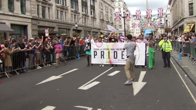 london pride parade parade starts moving with sadiq khan and others at front / various people in parade as along / closeup dog with rainbow scarf /... - music stand stock videos and b-roll footage