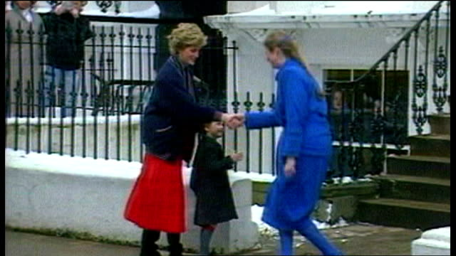 Prince William wearing coat and school cap arriving with the Princess of Wales for his first day at Wetherby School