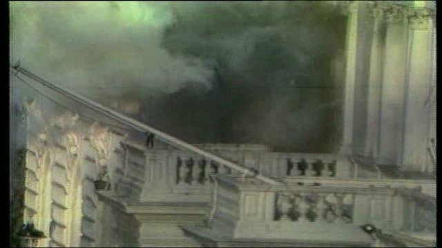 princes gate sas man on balcony of iranian embassy during siege as explosion blasts pull out as thick black smoke billows - belagerung stock-videos und b-roll-filmmaterial
