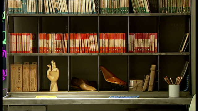 London property prices continue to rise Dining room Book case with paperbacks and ornaments Yellow coffee pot next book Kitchen Foil food containers...