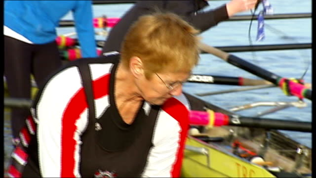 putney: thames rowing club: ext thames rowing club members lowering rowing boat into river sculls on river thames at putney pauline rayner and... - lowering stock videos & royalty-free footage
