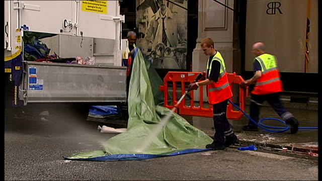 London Regent's Street EXT Various of council workers cleaning up outside Banana Republic department store where man killed after falling through a...