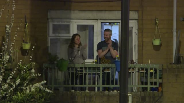 london residents clap and cheer from their balconies and windows as a sign of support for healthcare workers and others on the front lines of the... - window stock videos & royalty-free footage