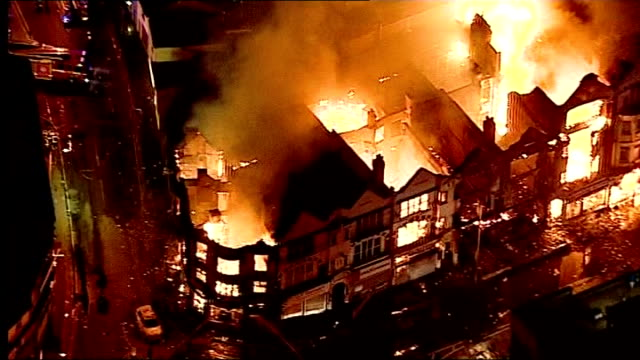 aerials of buildings on fire in croydon and enfield more air views of fire raging at the house of reeves furniture store and adjacent buildings - croydon england stock videos & royalty-free footage