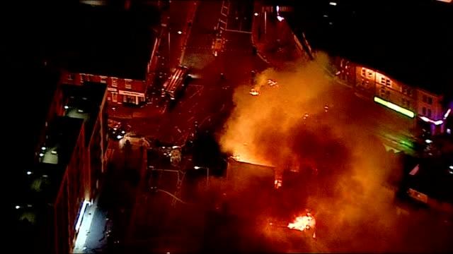 aerials of buildings on fire in croydon and enfield; england: london: croydon: ext / night air views of burning buildings - ロンドン クロイドン点の映像素材/bロール