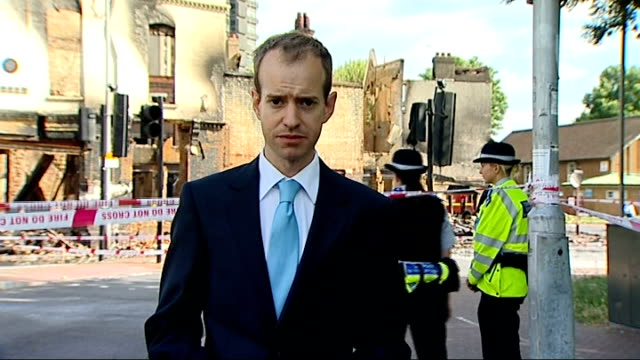further violence and unrest reporter to camera ealing kevin hurley interview sot london jankel armoured police vehicles along street following group... - ealing stock videos and b-roll footage