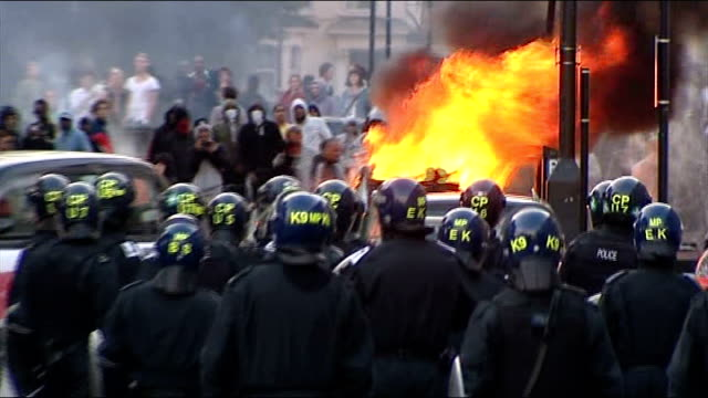 police release photographs of people jailed for rioting august 2011 england london riot police walking along road towards rioters - prison riot stock videos & royalty-free footage