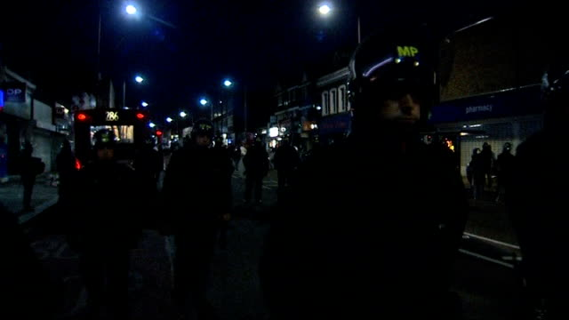 relatively quiet night after huge increase in police numbers youths confronting riot police line of riot police across main road downing street day... - water cannon stock videos and b-roll footage