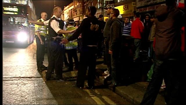 vídeos y material grabado en eventos de stock de vigilante groups threat england london jankel armoured police vehicles along deserted high street followed by regular police vans eltham large group... - bate de críquet