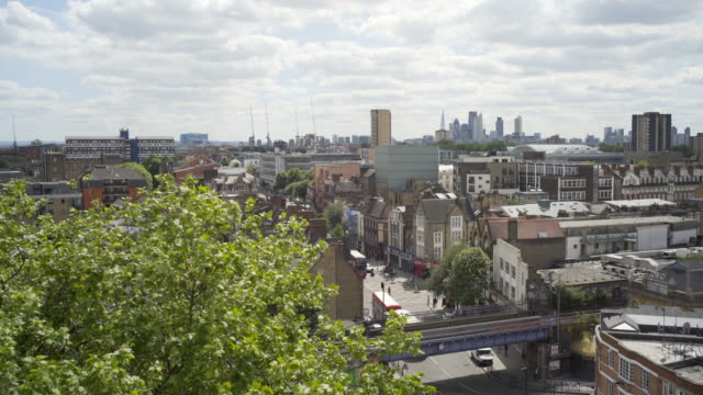 london rooftops and hackney central overground station. - doppeldeckerbus stock-videos und b-roll-filmmaterial