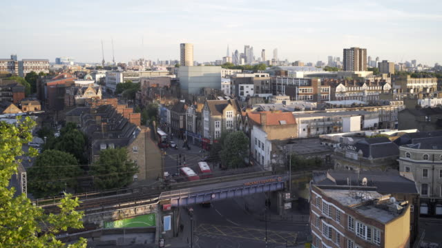 london rooftops and hackney central overground station. - double decker bus stock videos & royalty-free footage