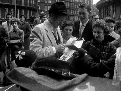 stars 'busking' for charity england london royal albert hall gv crowd ms ditto cs dickie valentine autographing tilt to girls ms john pertwee... - autographing stock videos & royalty-free footage