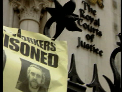 """london: royal courts of justice: gv group of demonstrators with placards outside court entrance imprisoned"""" poster with photos of the imprisoned the... - b rolle stock-videos und b-roll-filmmaterial"""