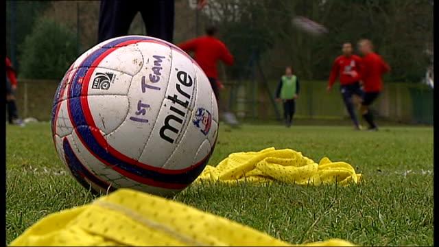 Selhurst Park Vox pop Crystal Palace FC fan Vox pop Crystal Palace FC fan EXT Football on grass marked '1st team' Crystal Palace squad training...