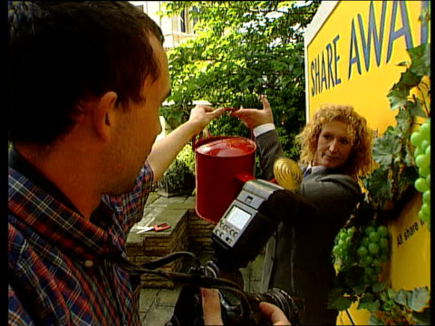 lib london seq tv gardener charlie dimmock taking part in photo shoot for campaign by stock exchange to encourage more people to invest in shares - charlie dimmock stock videos & royalty-free footage