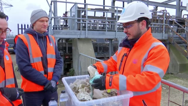London sewers clogged up with wet wipes Beckton Water Treatment Works Members of London Assembly being shown container full of wet wipes found at...