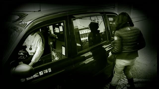 vídeos de stock, filmes e b-roll de black cab driver suspected graphicised reconstruction woman getting into black cab and driver offering her champagne - suspeita