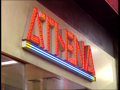 London LA MS Sign 'Athena' TX GV Athena store with 'Sale' notices in ITN window