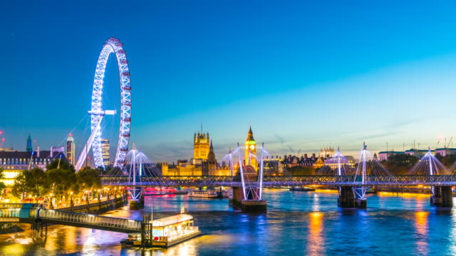 london skyline at dusk, time lapse. - millennium wheel stock videos and b-roll footage