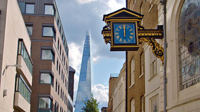 london skyline. clock. the shard building - stone object stock videos & royalty-free footage