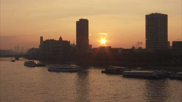 London skyline in silhouette beside the River Thames Available in HD.