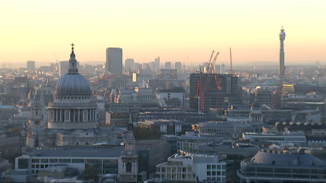 london skyline including at sunset england london ext orange sky high angle shot city of london skyscrapers including 20 fenchurch street / hazy... - bt tower london stock videos & royalty-free footage