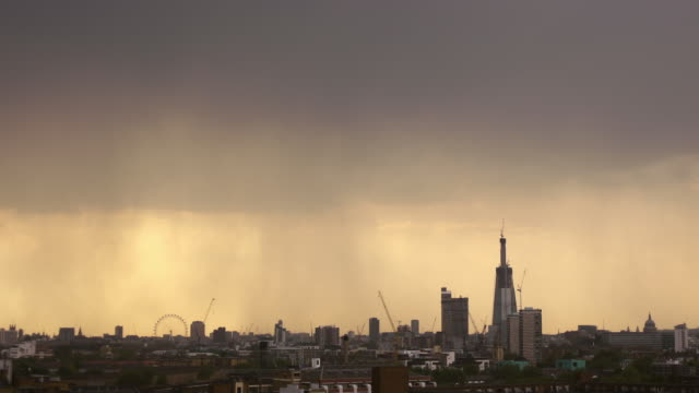 ws t/l pan london skyline rainstorm at dusk / london, united kingdom - rain stock videos & royalty-free footage