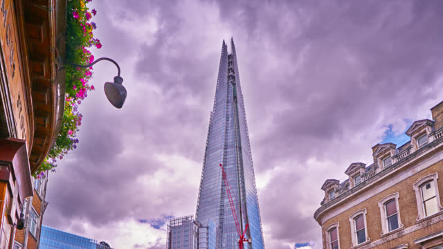 london skyline. the shard. famous financial center. moody dramatic sky. - temple building stock videos & royalty-free footage
