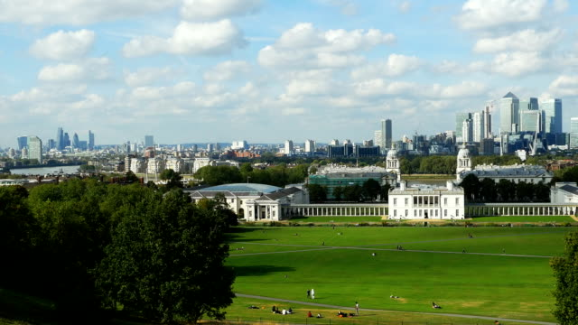 london skyline viewed from greenwich park (4k/uhd to hd) - royal navy college greenwich stock videos & royalty-free footage