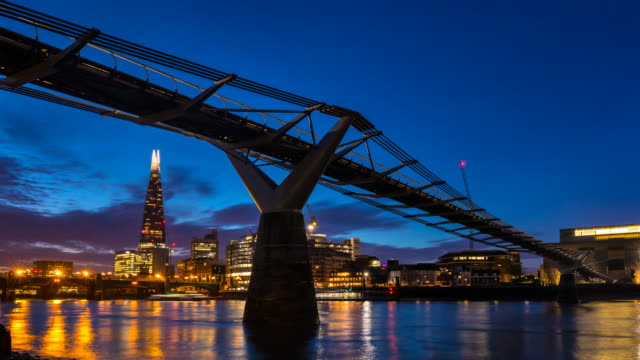 london skyline with millennium bridge, the shard and tate modern museum at dawn, tl, zo - london millennium footbridge stock videos & royalty-free footage