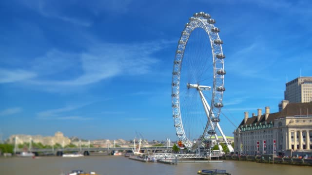 london skyline with the london eye millennium wheel and river thames. - big wheel stock videos & royalty-free footage