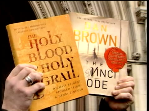 june; in 1964 author dan brown was born lib london: slow motion people holding copies of 'the holy blood the holy grail' and dan brown's 'the da... - author stock videos & royalty-free footage