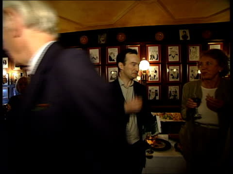 london: soho: ext/night people gathered outside 'gay hussar' pub where former labour politician, michael foot, is celebrating his 90th birthday int... - gerald kaufman stock videos & royalty-free footage