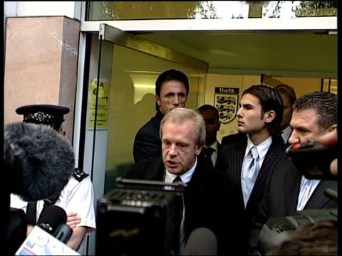 London Soho Square EXT Adrian Mutu wearing pinstripe suit arriving at Football Association headquarters with his lawyers Gordon Taylor speaking to...