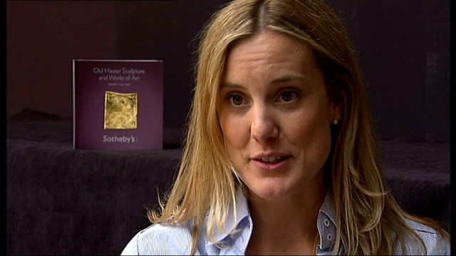 sotheby's int reporter to camera close shots of 500 year old gold pendant showing holy trinity carolyn miner interview sot talks of being shocked at... - pendant stock videos & royalty-free footage