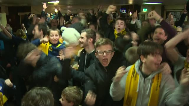 stockvideo's en b-roll-footage met london sporting highlights of 2017 tx sutton int various shots sutton united supporters cheering and celebrating on hearing they are to host arsenal... - fa cup
