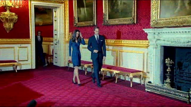 London St James's Palace INT Prince William and fiancee Kate Middleton into room for photocall to mark their engagement ZOOM IN engagement ring which...