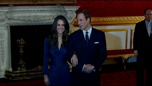 london st james's palace int sapphire engagement ring pull out to kate middleton and prince william smiling for cameras and along from room - fidanzamento video stock e b–roll