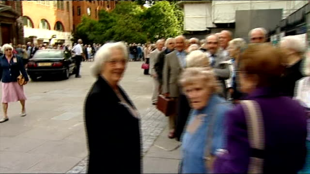 London St Paul's Cathedral EXT People queuing up to attend commemorative service to mark the 70th anniversary of the evacuation of British citizens...