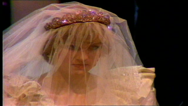 london: st pauls: diana wearing wedding dress designed by the emmanuels at her wedding as along with father and prince of wales and in carriage after... - father stock videos & royalty-free footage